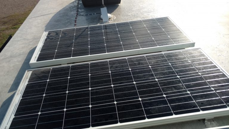 Solar panels installed on a fifth wheel trailer.