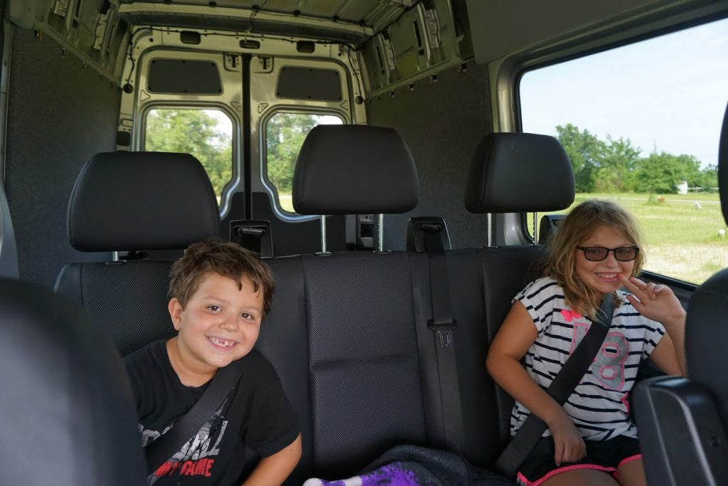 Kids in the back of the Sprinter 2500 Crew before conversion was complete.