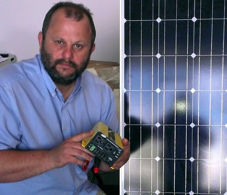 Chad showing solar and inverter used to run off-grid office.