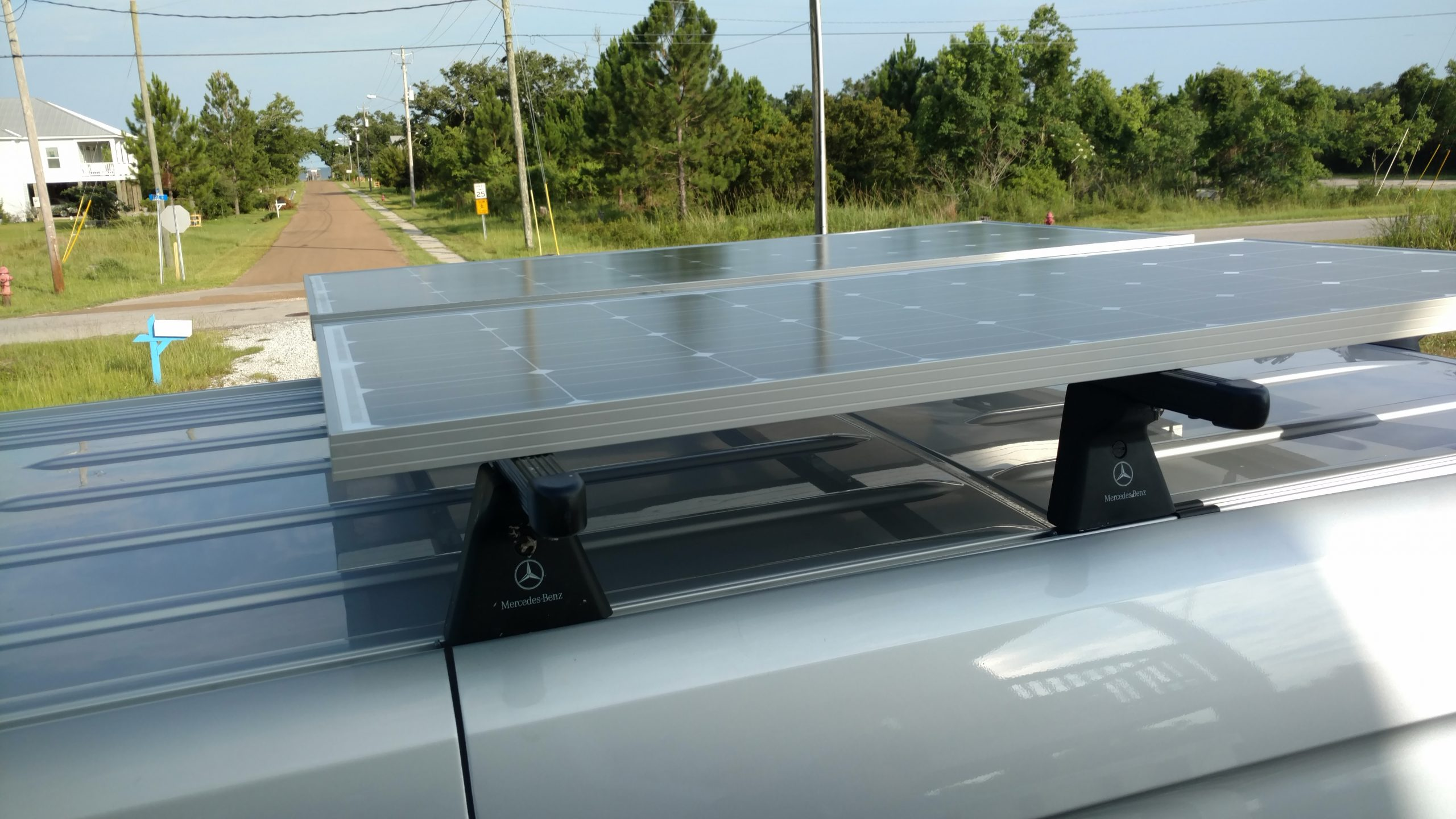 Solar panels on a roof rack can be cooler since there is 4 inches between roof and panel.